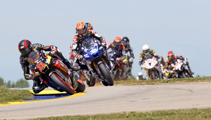 Saturday first lap Honos Pro Superbike race action with MotoAmerica at Road Atlanta: eventual victor Mat Scholtz on the Westby Yamaha leads the Fresh 'N' Lean Attack Yamaha of Sunday winner Jake Gagne.