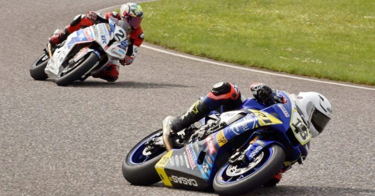 Tommy Casas (18) on a Yamaha holds first in the Pro Superbike Feature from BMW pilot Samuel Guerin (2). CREDIT: Colin Fraser / CSBK