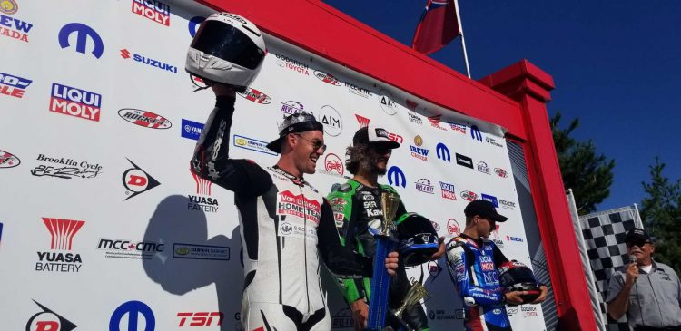 """Newly crowned """"King of Mosport"""" Ben Young celebrates on the Canadian Tire Motorsport Park podium with two race winner Jordan Szoke and Championship leader Alex Dumas. CREDIT: CSBK"""